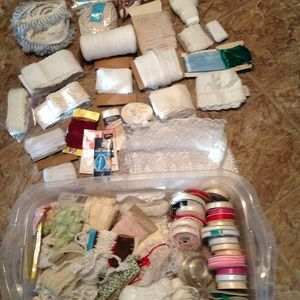 Ribbons and lace and assortment of craft supplies